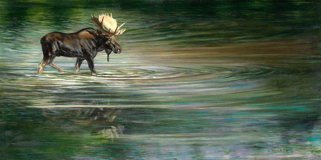 A moose slowly crosses a lake