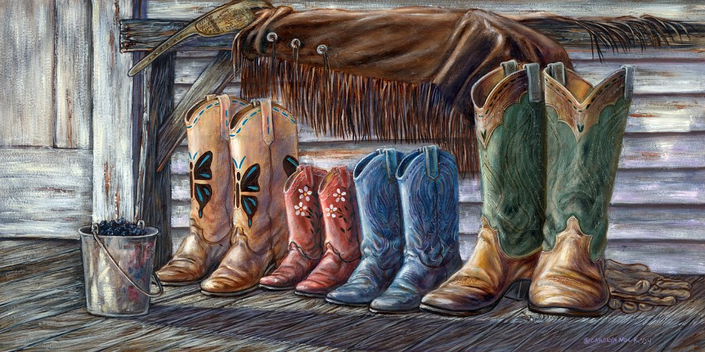 A family's boots sit next to each other on a wood porch