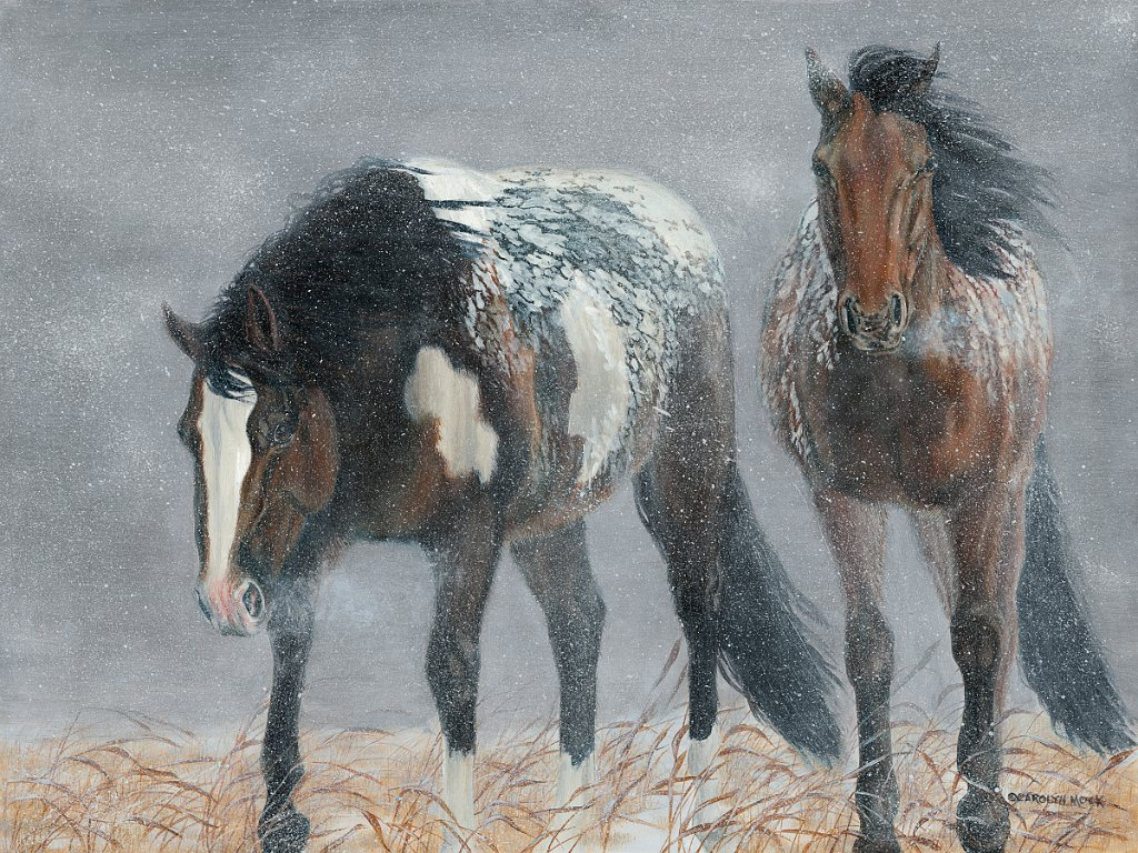 Two horses graze in a show-covered field
