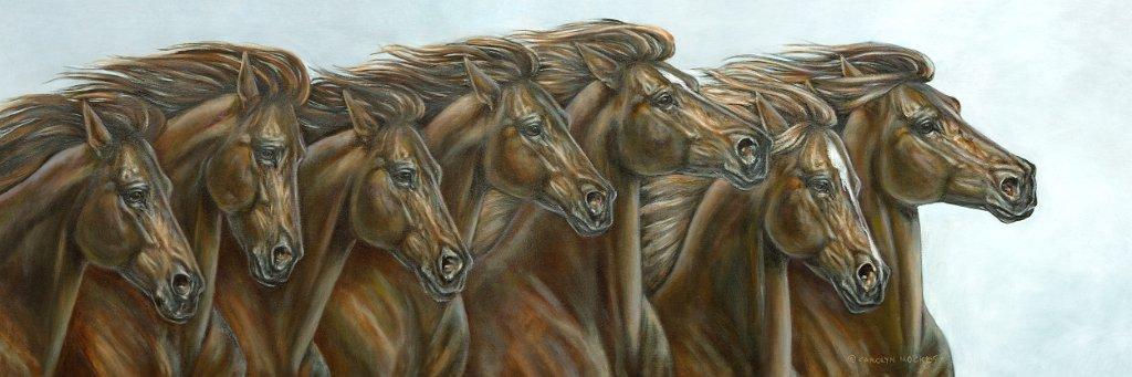 A herd of horses run in a field
