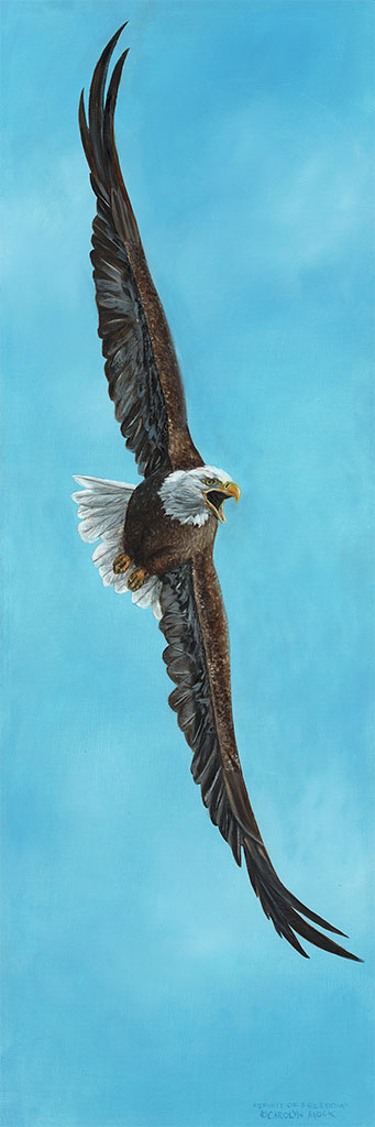 An eagle takes flight in a blue sky