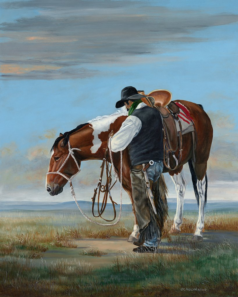 A man prepares his horse as he finishes up for the day